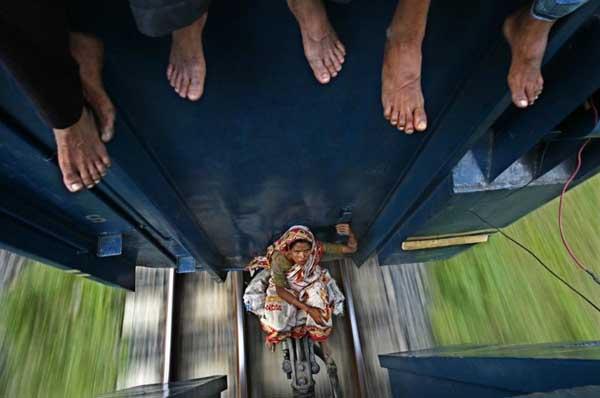 Woman on train by Andrew Biraj