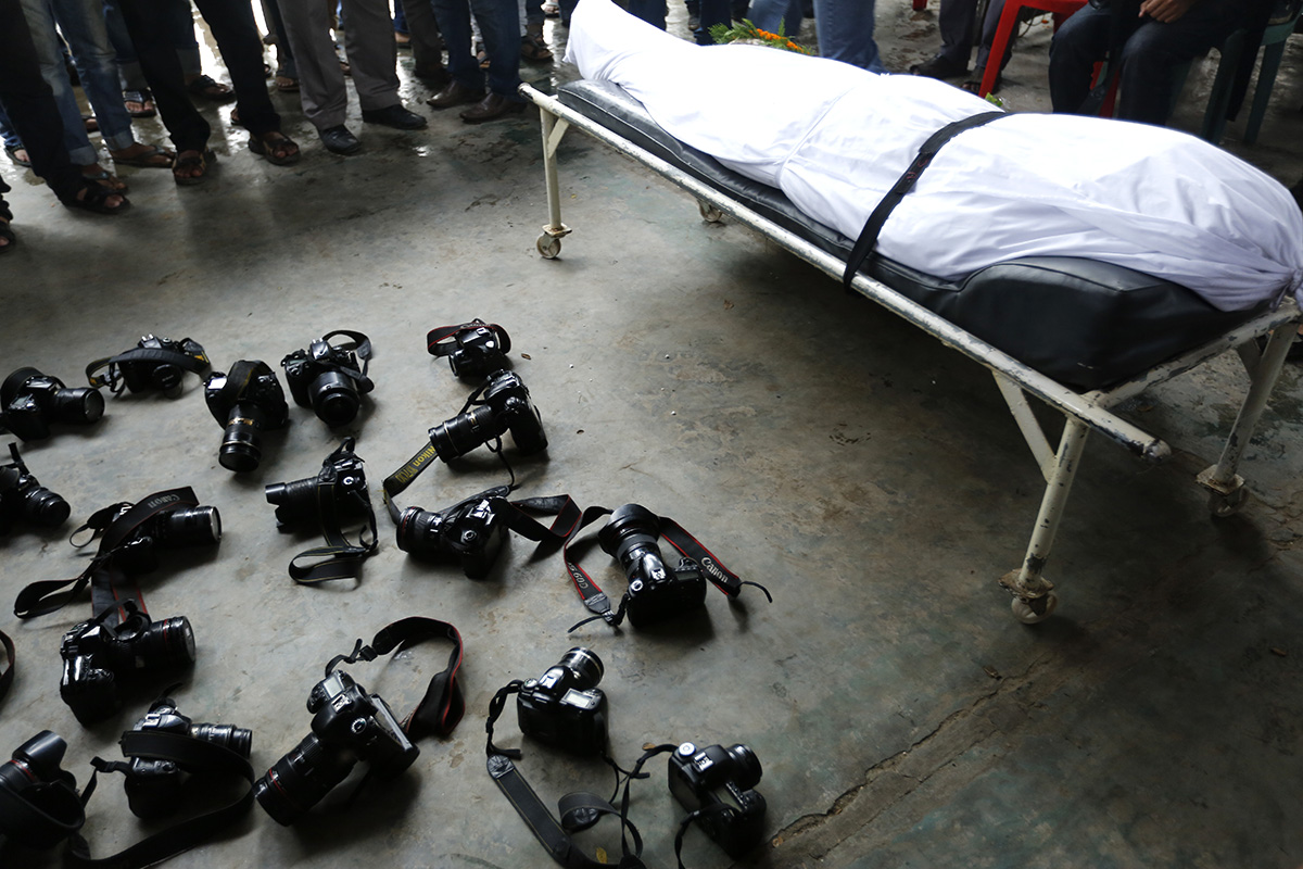 Homage to Azizur Rahim Peu by the photographers/photojournalists after his janaja. Photo: Abir Abdullah
