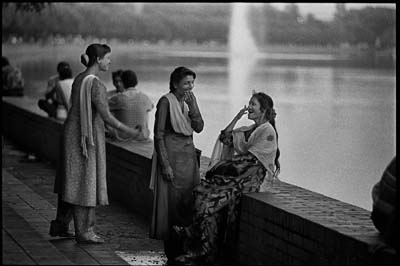 Hajera (right) and her friends by Crescent Lake in the parliament grounds. Photo: Shahidul Alam/Drik/Majority World