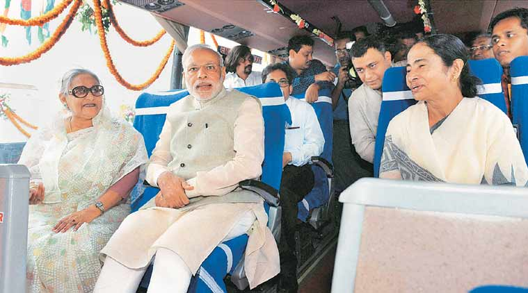 PMs Hasina, Modi and CM Mamata Banerjee flagging off a bus service between Bangladesh and India, in Dhaka Saturday. (Source: PTI) - See more at: http://indianexpress.com/article/india/india-others/india-bangladesh-seal-historic-land-boundary-agreement/2/#sthash.sxgId5nZ.dpuf