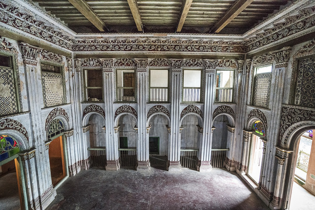 The dance hall of Panam Nagar, Sonargaon, Bangladesh. Heavily frescoed walls depict the old glory of the ball room at Panam Nagar. Nobles and other well-off citizens would indulge in expensive habits, which included the use of muslin. Photo: Shahidul Alam/Drik/Majority World