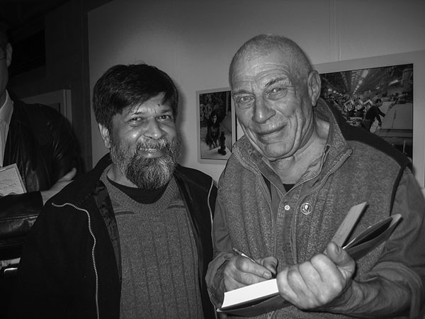 John Berger signing book for Pathshala, and Shahidul Alam, at South Bank in London. Photo by Paul Bryers